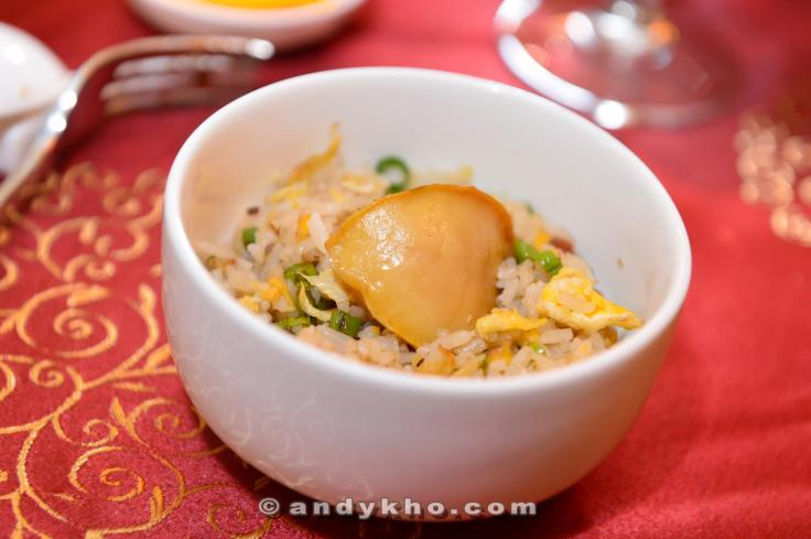 Fried rice with Bacon bits, topped with Abalone.