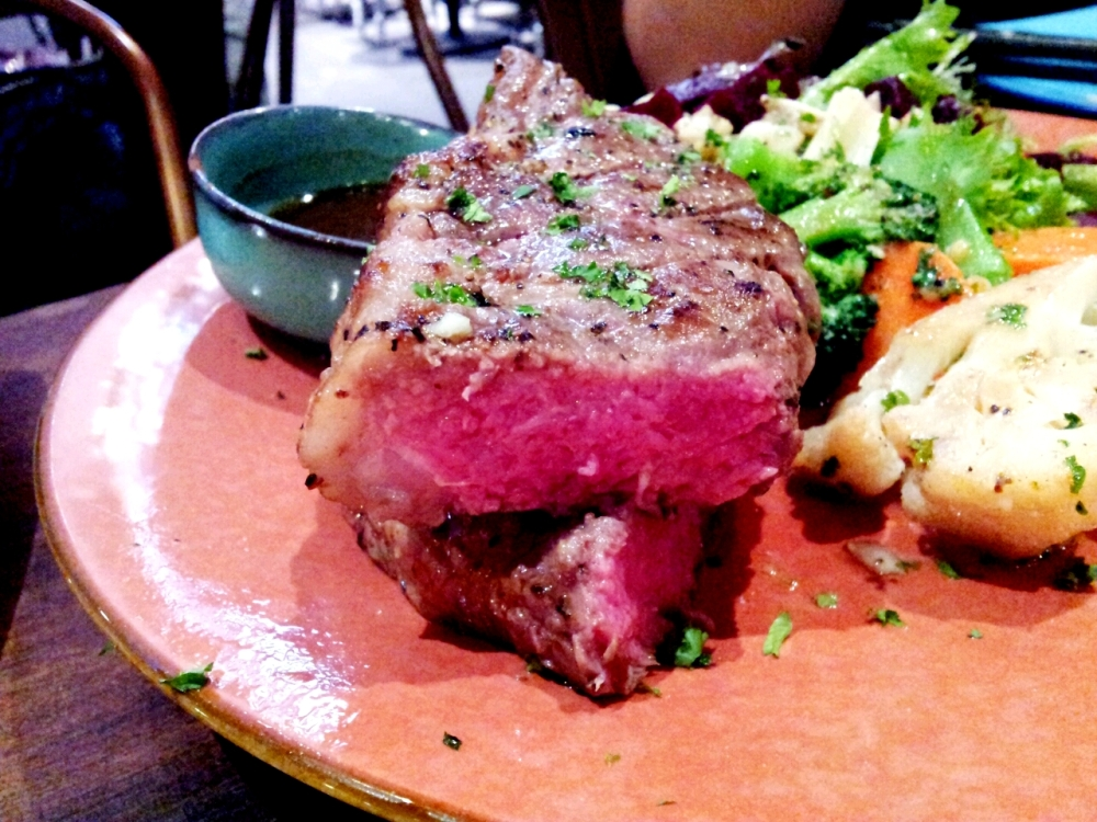 Striploin with colourful salad.