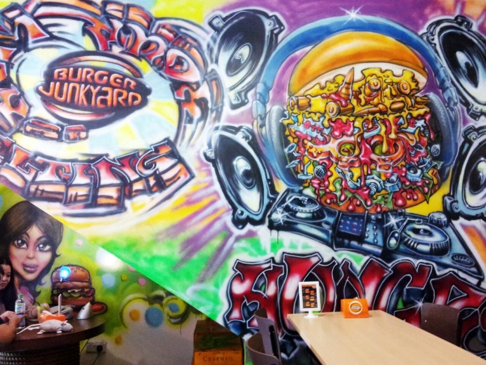 Graffiti wall adds to the Junkyard vibe.