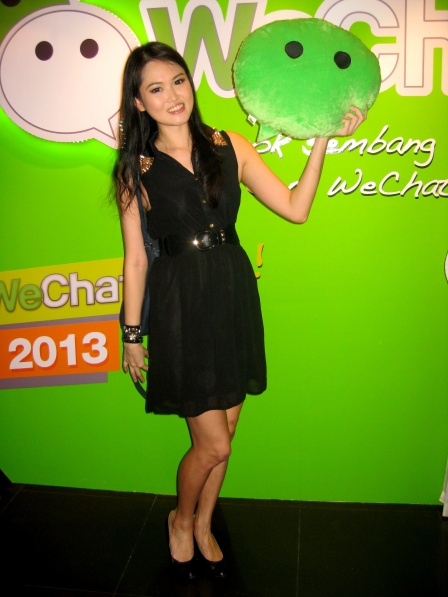 Posing with the WeChat Speech Bubble Plushie.
