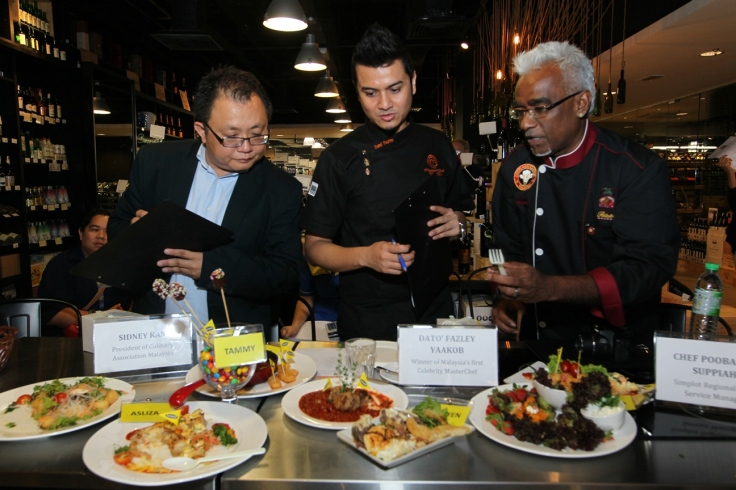 The judges tasting all the dishes.