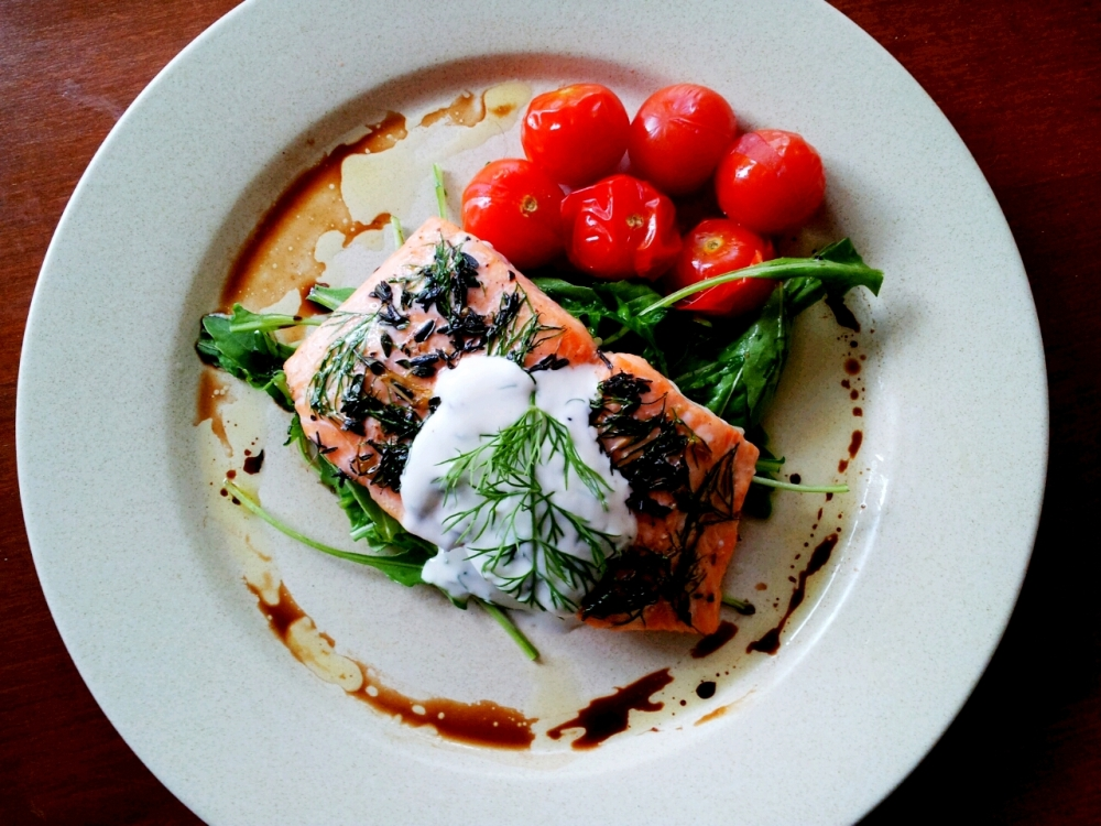 Lemon and Herbs Baked Norway Salmon, Dill Yoghurt Sauce, Wild Rocket, Roast Cherry Tomatoes.