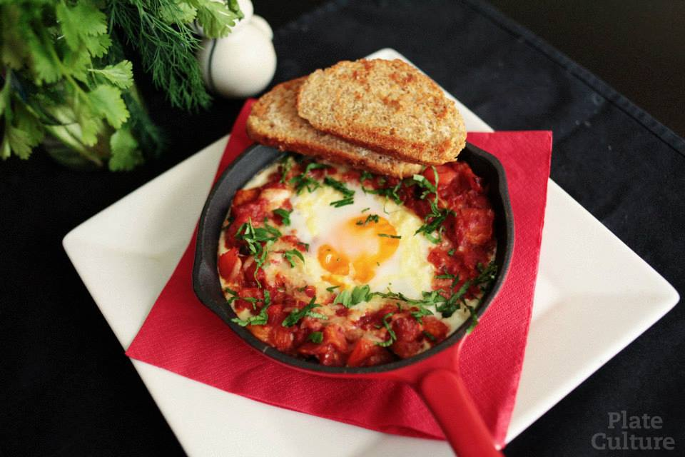 Baked egg with bacon, capsicum and zucchini. The combination might change based on availability.