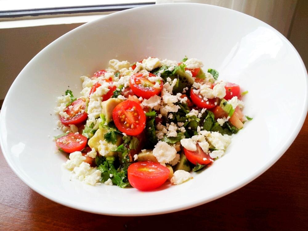 Kiwi Salad with Tomato, Avocado and Feta Cheese.