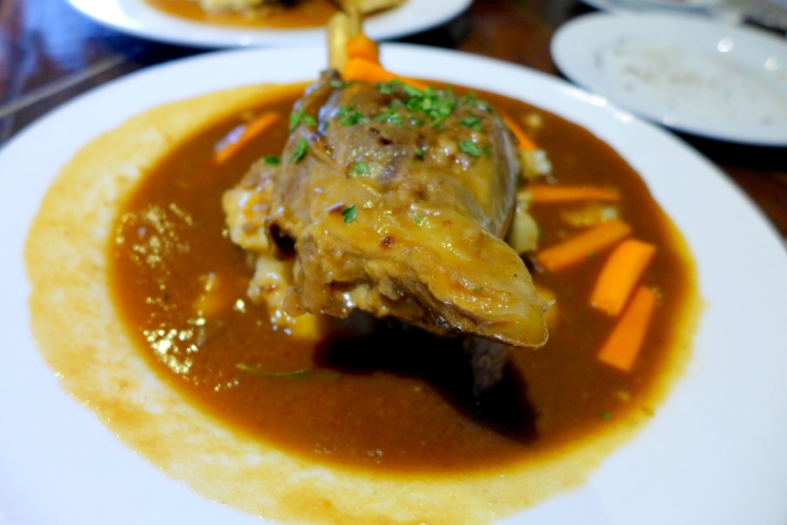 Stinco D'Agnello Wood fired oven braised lamb shank in a rosemary sauce on a bed of  mashed potato