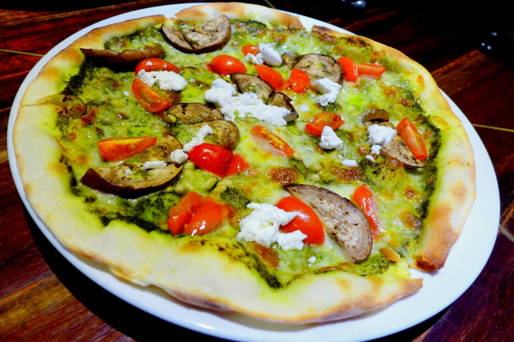 Pizza Vegetali RM27 Grilled eggplant, roasted cherry tomato, pinenut, pesto, ricotta cheese, tomato & mozzarella.