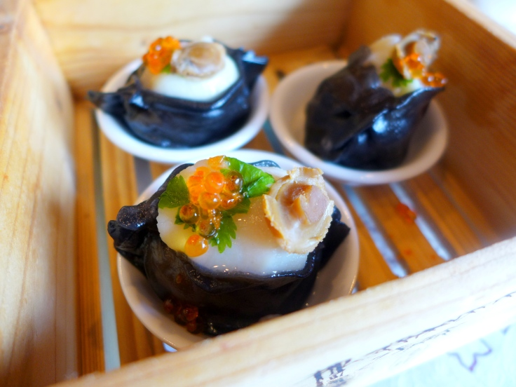 Squid Ink Scallop Dumpling topped with Salmon Roe