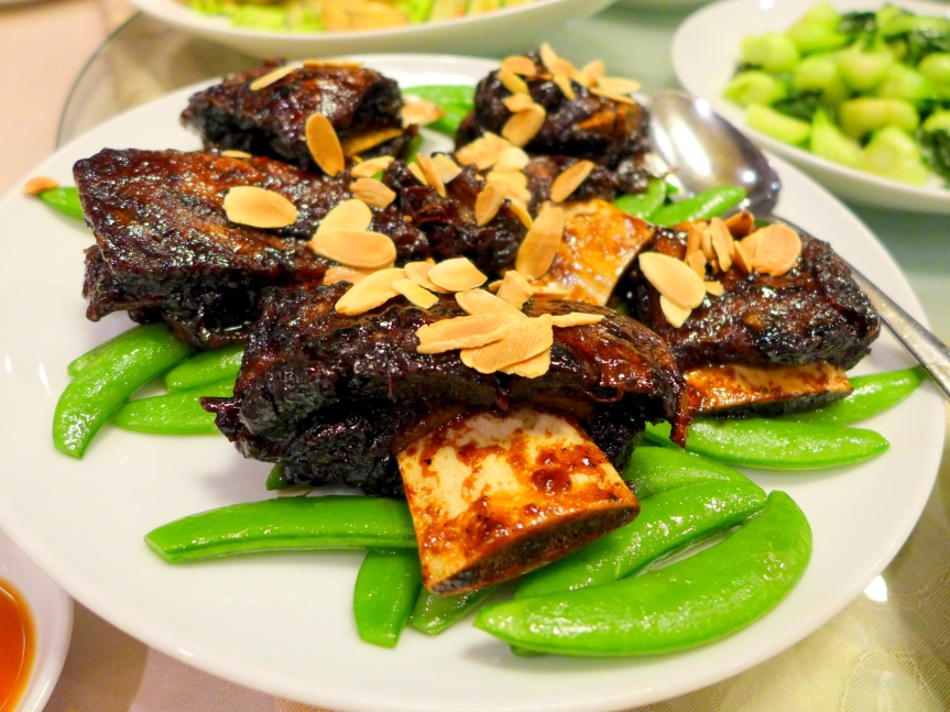 Braised Beef Short Ribs drizzled with coffee sauce and almond flakes
