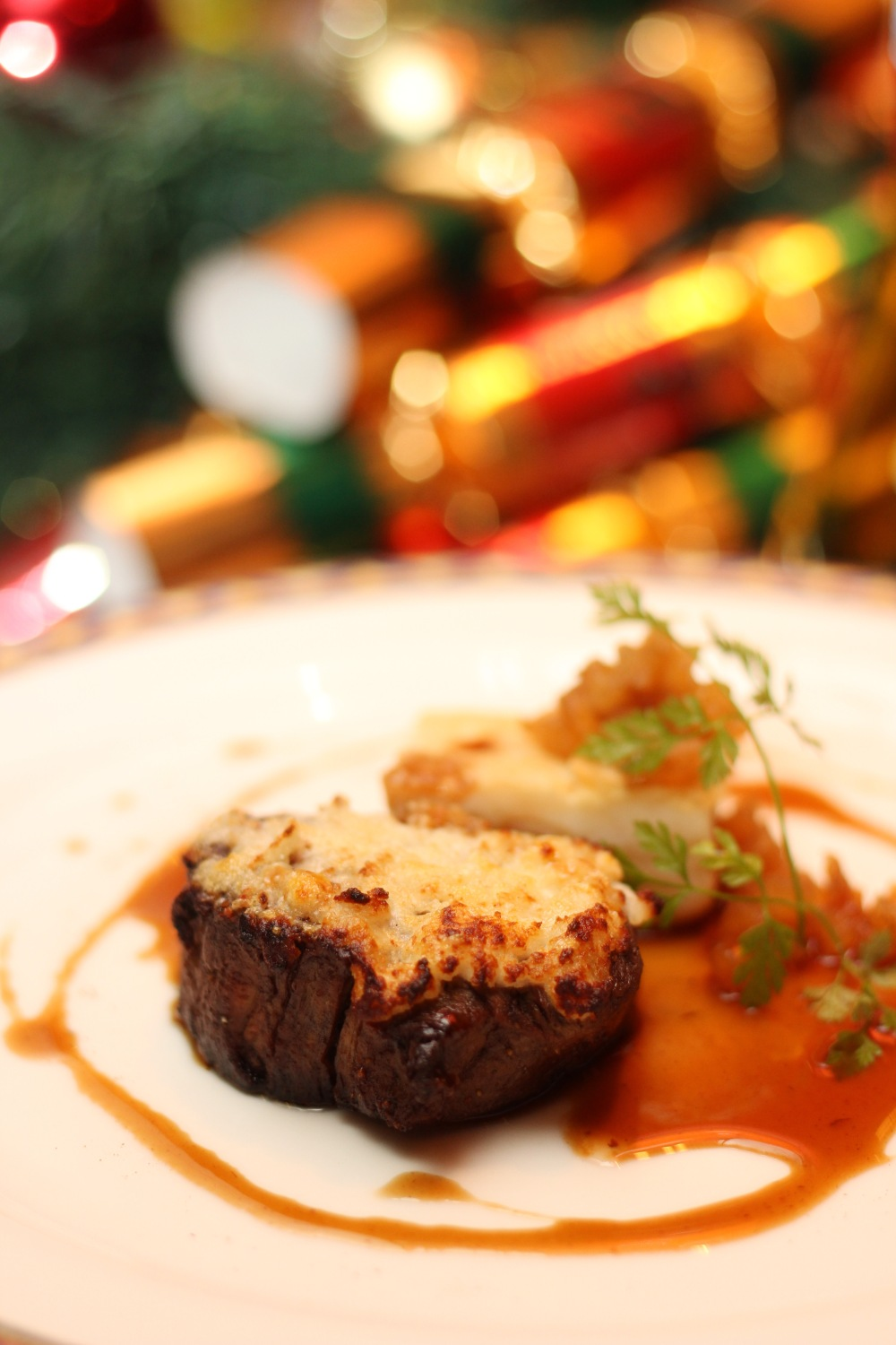 Crusted White Pepper Beef Tenderloin with Buche de Chevre Gratin, Pear Compote and Celeriac Mille Foille