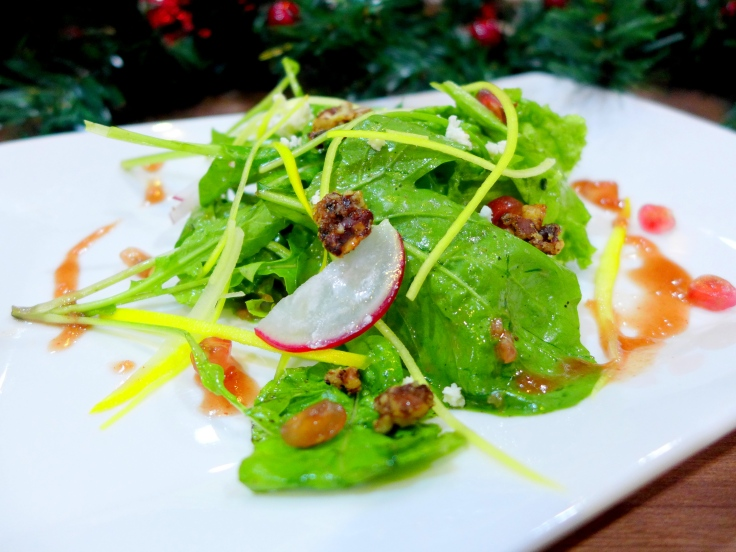 Pomegranate Salad Fresh salad leaves and yellow zucchini toss with tangy sweet pomegranate dressing, accompanied with feta cheese and honey roasted pecan nuts
