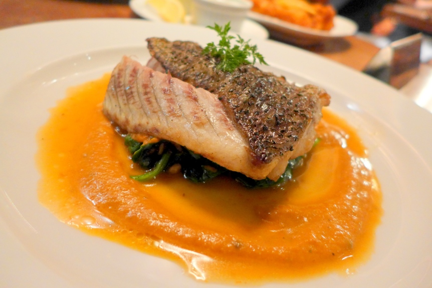Sea Bass with Sauteed Spinach and Sun-dried tomato cream sauce