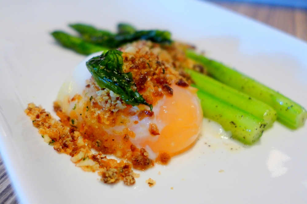 Butter Poached Asparagus, Sous-vide Egg, Sultana and Shaved Almond Panna Grattato, Truffle Honey.