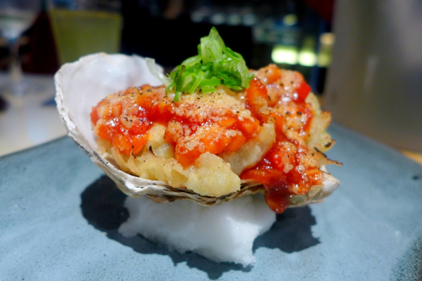 Baked Fresh Oysters with Garlic flavoured Tomato and Cheese