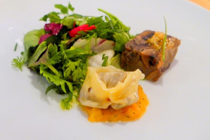 Roasted portobello pave with smoked garlic vinaigrette, mushroom tortellini with tomato fondue and herb salad