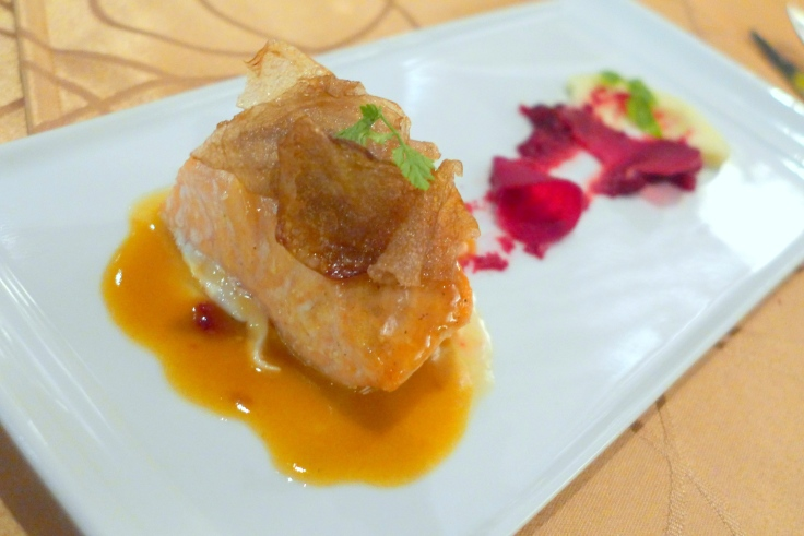 Salmon mi-cuit with pickled beets, cauliflower mousseline, potato chips and spiced butter sauce
