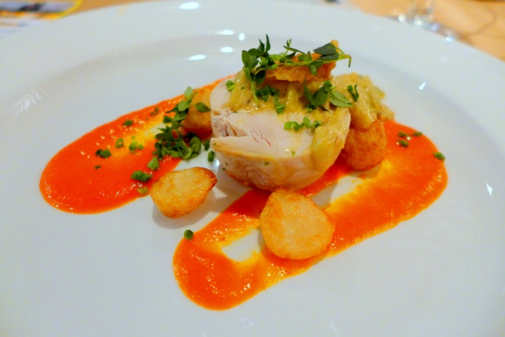Sous vide chicken with crispy skin, creamy leek stew, golden potatoes and red pepper emulsion